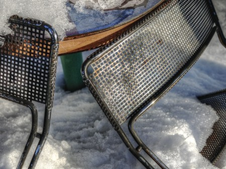 Metal chair backs in the snow.