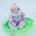 Child in snow saucer.
