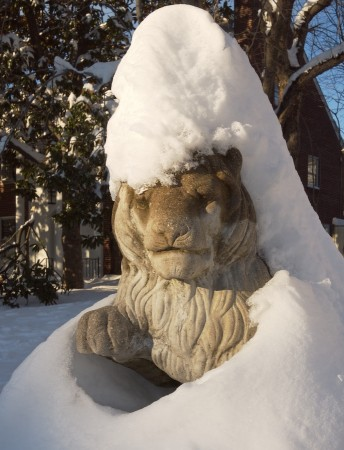 Stone sculpture covered in snow.