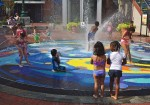 Children play in the fountain at Silver Spring, MD
