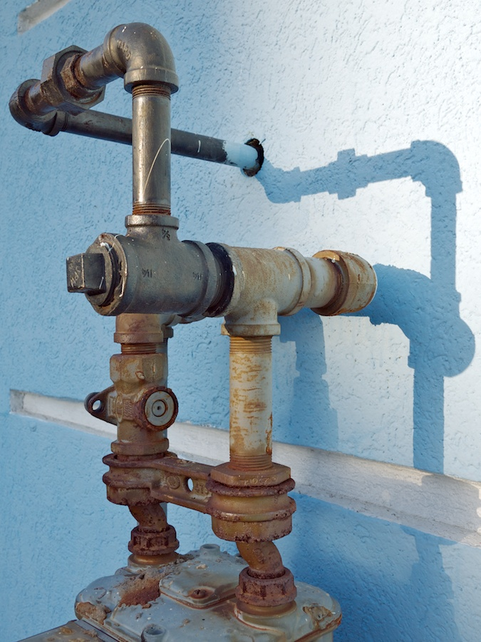 Pipes and blue wall.