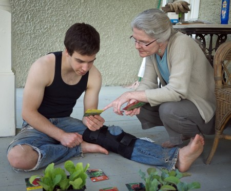 Mother and son consider garden choices.