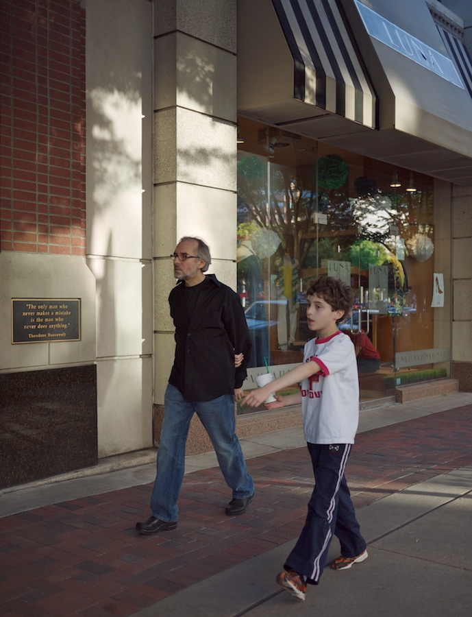 Father and son pedestrians.
