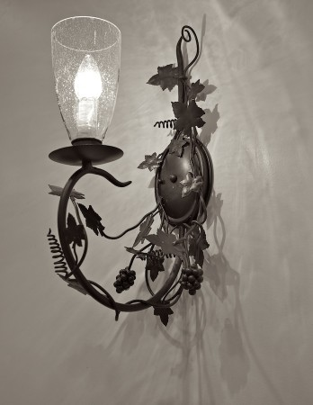 Cast iron wall sconce.