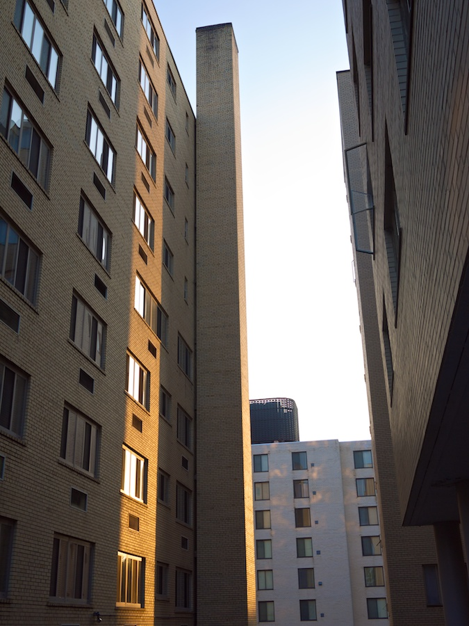 Late afternoon light between buildings.