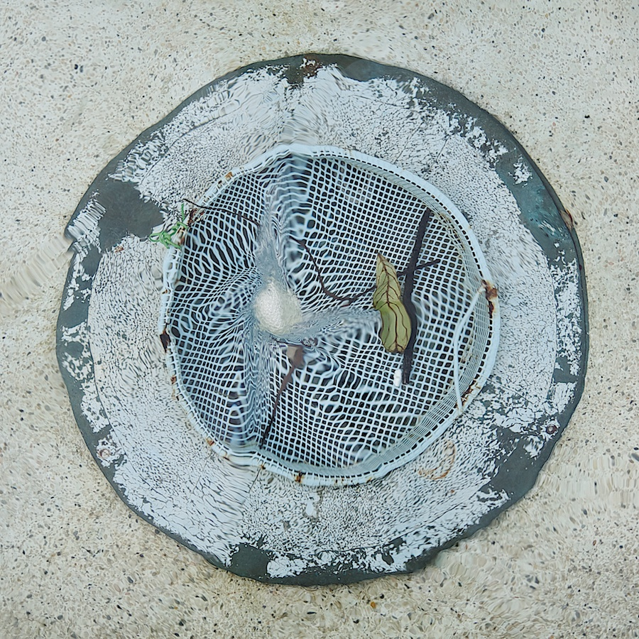 Fountain pool drain.