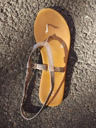 Broken sandal.
