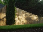 Wooden fence in late afternoon light.