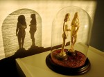 Ivory sculptures of Adam & Eve in a bell jar.