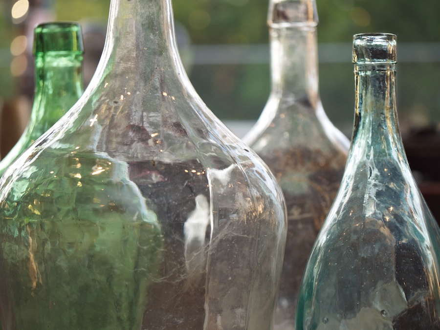 Large glass bottles in store display.