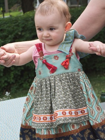 Little girl in crafty dress.