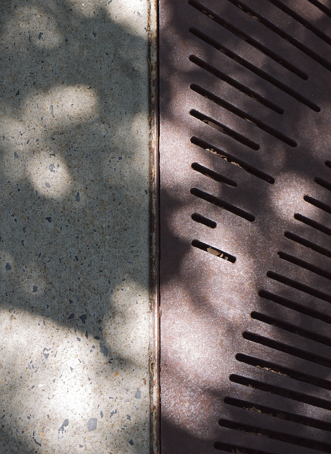 Pavement and grating.