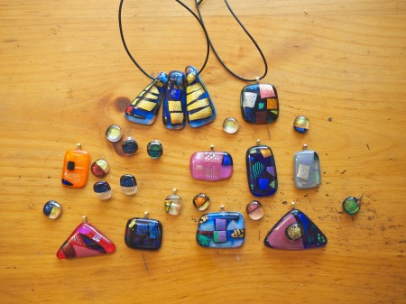 Fused dichroic glass pendants and jewels.