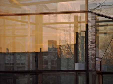 Layered reflections in glass.