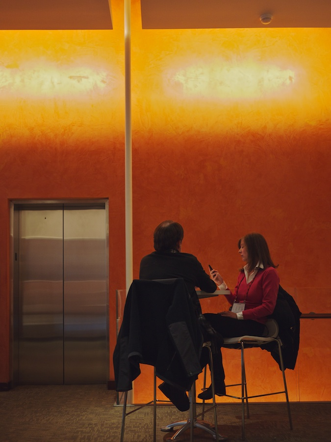 Couple in silhouette at table.