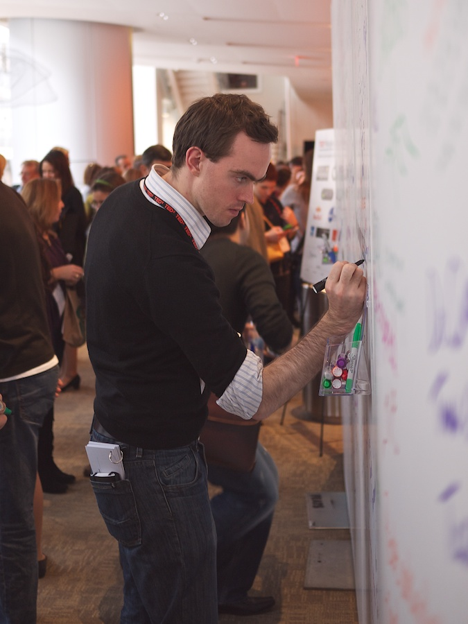 Man writing on comment wall, TEDxMidAtlantic