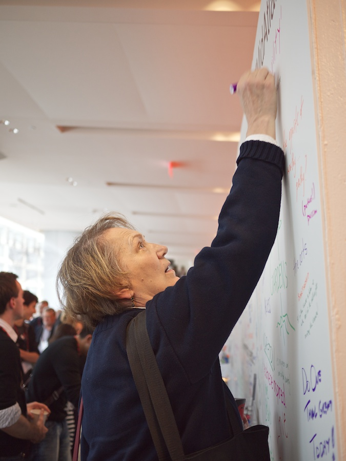 Woman writing on community wall at TEDxMidAtlantic 2011
