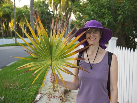 Amy holds a palm branch in the Truman Annex.
