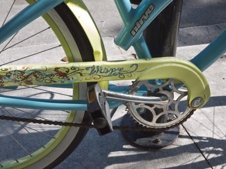 Wispy tattoo on bicycle.