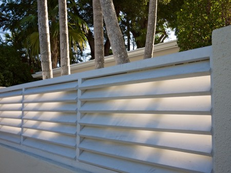 Slatted fence and palm trees, Key West.