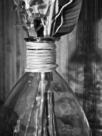 Glass vase with raffia.