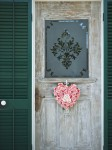Front door with flower heart wreath in Old Town, Key West.