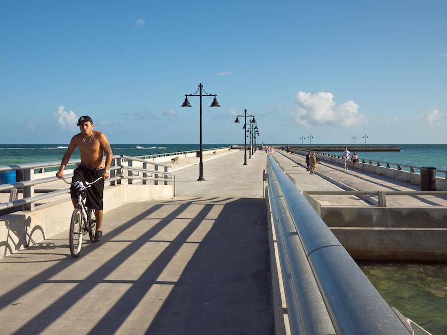 Bicyclist and pedestrian on pier, Key West, FL