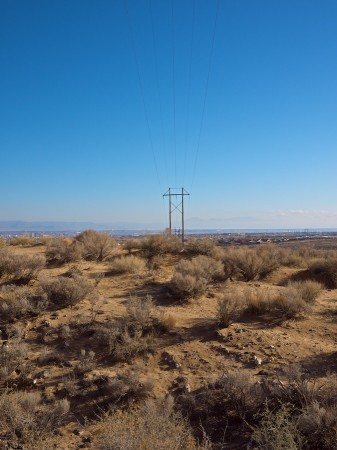 Desert, wires, mountains, sky.