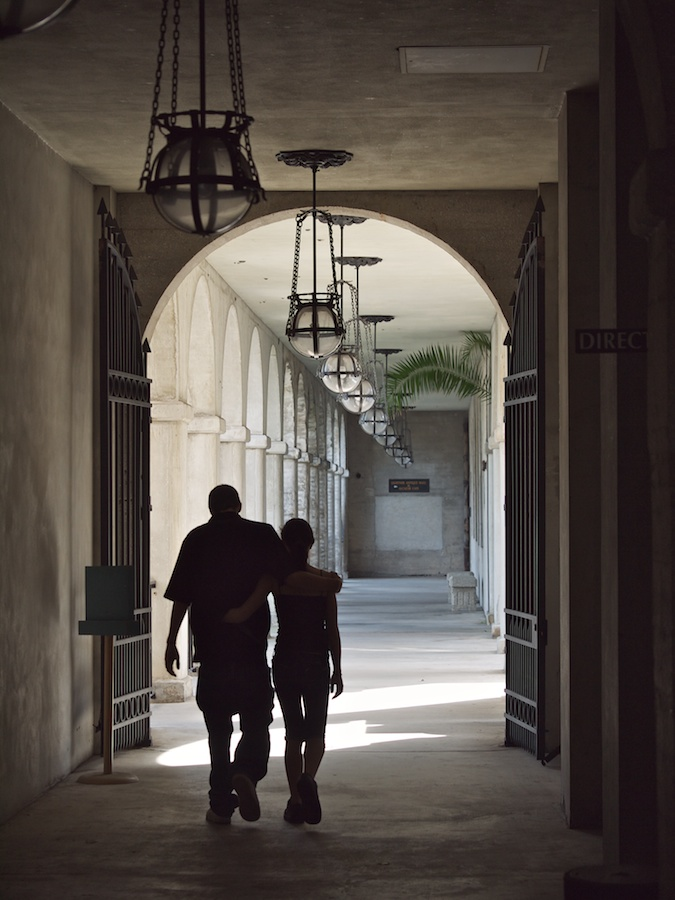 Couple walking through archway