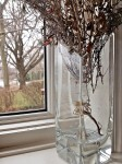 Dried flowers, vase, windowsill.