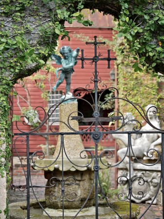 Iron gateway and garden sculptures, St. Augustine, FL