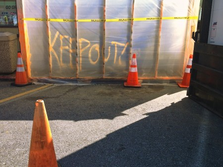 Construction materials and spray-painted warning.