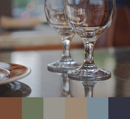 Glass on tabletop with color palette.