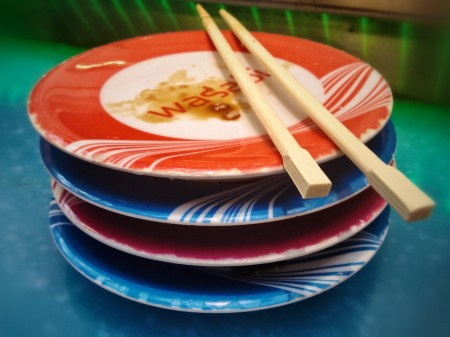 Stack of empty sushi plates, Wasabi Restaurant.