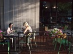 Two women dining outdoors.