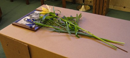 Flowers on coffin.
