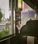 Man reflected in metal surface at diner.