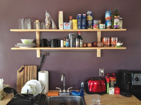 Shelves with food, sink, and counter top.