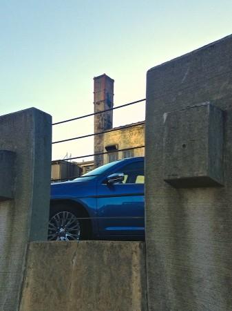 Blue car in parking garage.