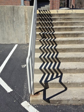Cement steps with zigzag shadow.