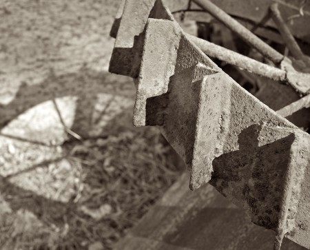 Black and white image of scrap metal and shadow.