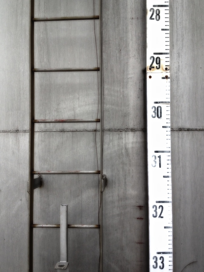Storage tank ladder and measure.