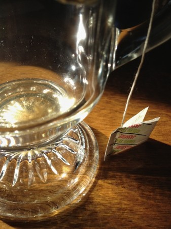 Empty glass and tea tag.