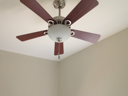 Ceiling fan and freshly painted walls.