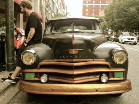 Guy leaning on vintage Plymouth, Asheville NC