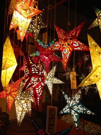 Hanging star-shaped lamps in shop window.