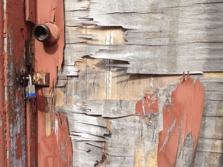 Peeling door surface and lock.