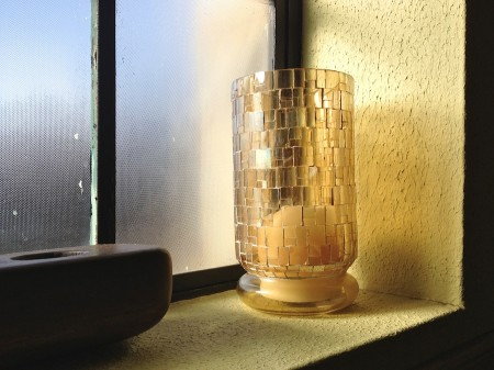 Candle lantern in windowsill.