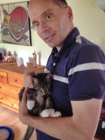 Bob holding kitten Loki.