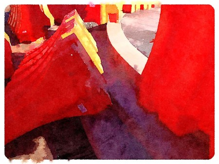 Watercolor style picture of orange traffic barriers.